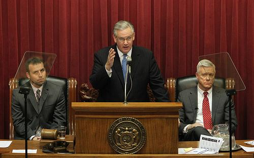 Governor Jay Nixon delivers the State of the State speech to the legislature in the House of Representatives chambers as Speaker of the House Steve Tilley (L) and Lt. Governor Peter Kinder (R) at the State Capitol in Jefferson City, Mo. in January 2011.