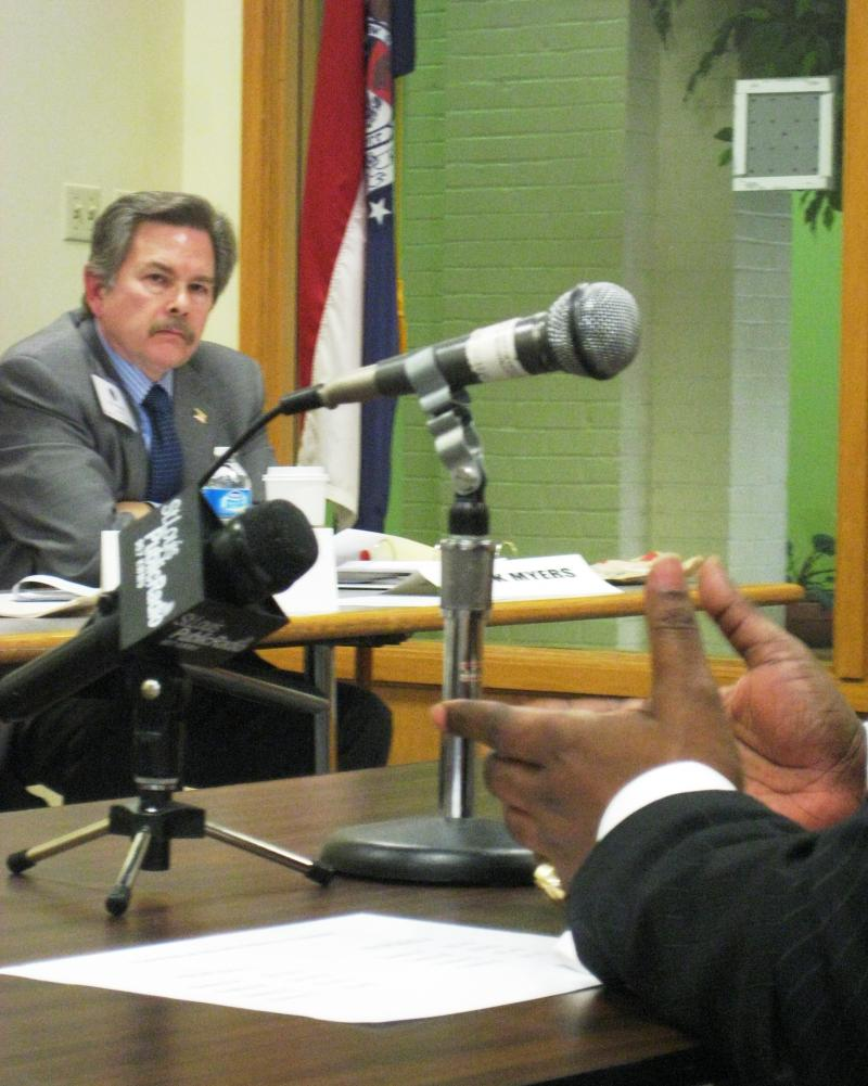 Senate Apportionment Commission member Nick Meyers (left) listens to redistricting concerns at a public hearing in St. Louis.