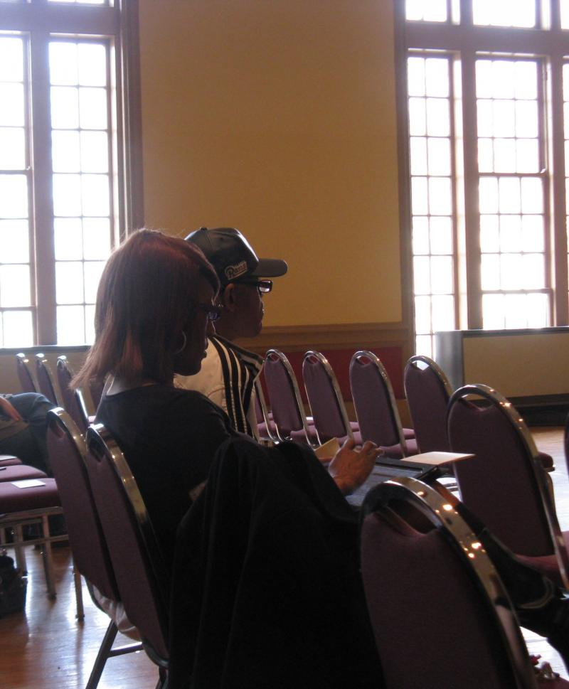 Sharon Parker takes notes during Schmidgall's sermon. Parker says she had been praying for a church like Middle Tree for five years.