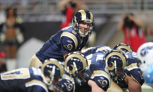St. Louis Rams quarterback Sam Bradford looks over his line at the Tennessee Titans defense in the second quarter at the Edward Jones Dome in St. Louis on August 20, 2011. The Rams will host games in London over the next three seasons.