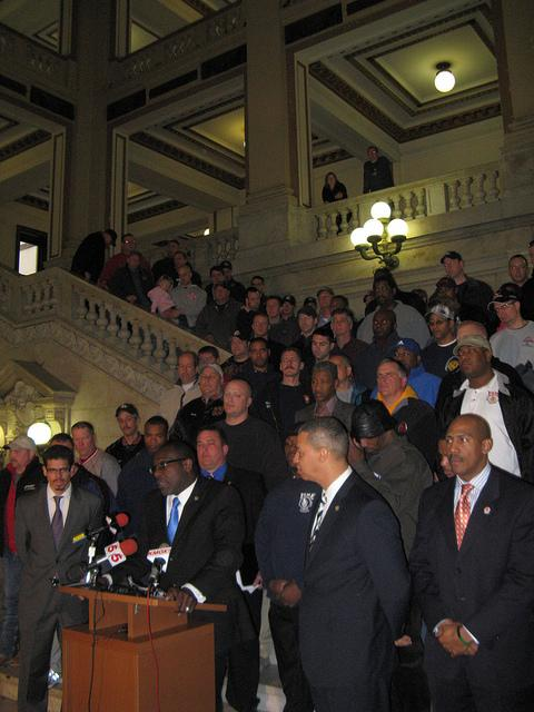Board of Aldermen president Lewis Reed (center bottom) outlines a deal he has reached with firefighters on reductions to their pensions - a deal not supported by Mayor Francis Slay.