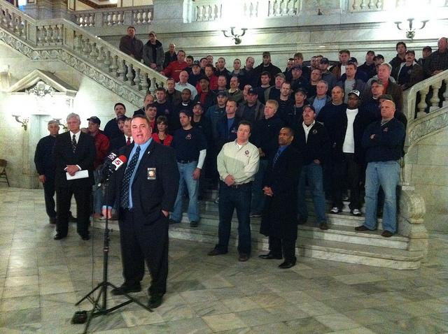 IAFF Local 73 president Chris Molitor, front, outlines his union's objections to proposed pension changes at City Hall on February 10, 2012.