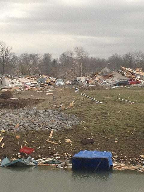 Damage to a neighborhood in Harrisburg, Ill. following severe storms on Wednesday morning.