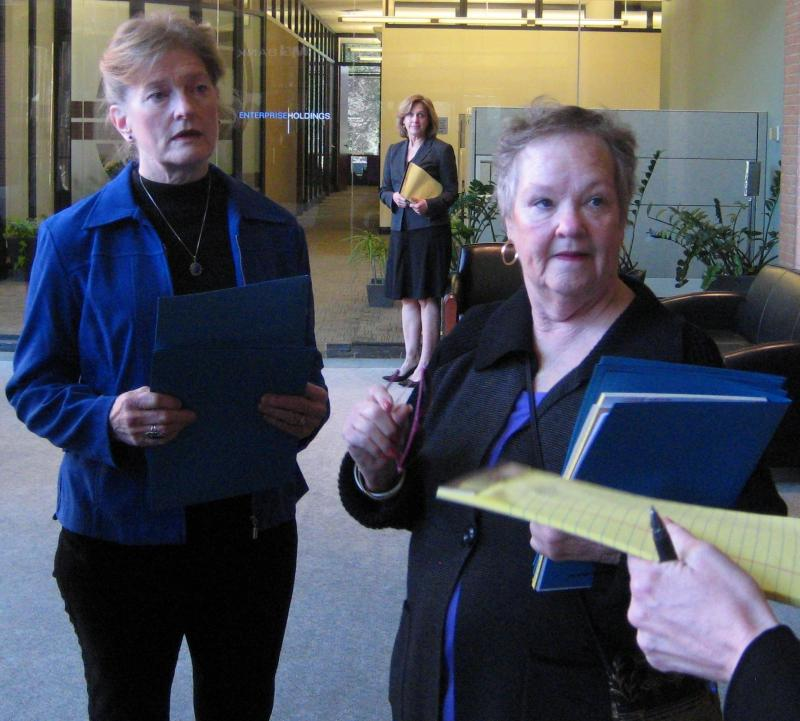 Joan Bray (left) and Judi Roman (right) of the Consumers Council of Missouri meet with representatives of Enterprise Rent-a-Car at their corporate headquarters.