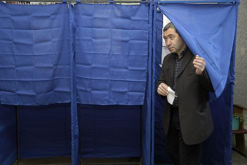 A voter leaving a voting booth in Georgia in 2010. Missouri will hold its presidential primary tomorrow.