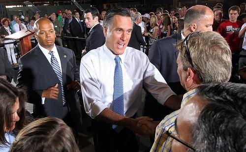 Republican Presidential candidate Mitt Romney shakes hands of supporters during a campaign stop at Production Products in St. Louis on June 7, 2012.