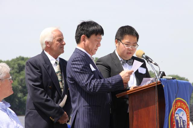 Grafton Mayor Tom Thompson (left) and Lu Xu Wu (center) speaking through an interpreter