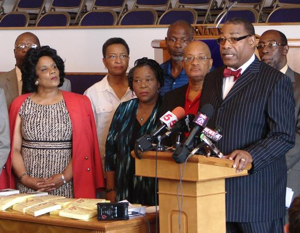 Rev. C.  Jessel Strong, president of the Clergy Coalition of Greater St. Louis, (right) called for area congregations to assist elderly and disabled residents during this year's heat wave.