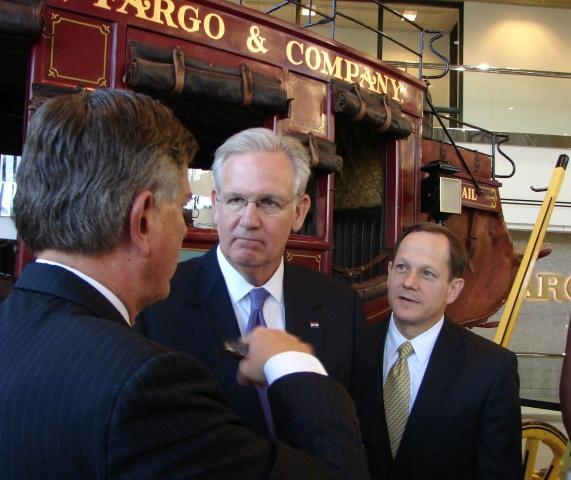 Mo. Gov. Jay Nixon (center) and St. Louis Mayor Francis Slay (right) joined Wells Fargo Advisors president and CEO Danny Ludeman at the company's headquarters in downtown St. Louis.
