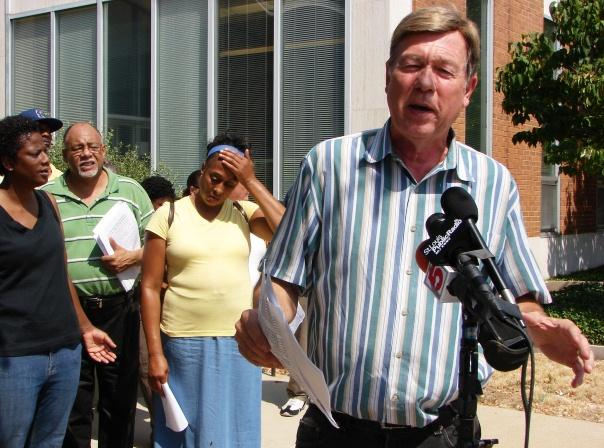Rev. Larry Rice spoke with reporters outside the Belleville Municipal Building Tuesday.