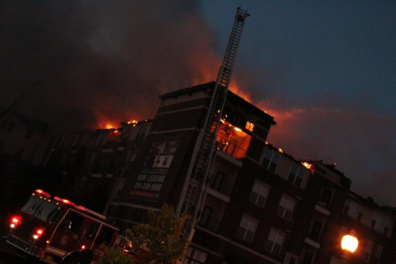 A five alarm fire burns into the night at an apartment complex in Midtown St. Louis on July 17, 2012.
