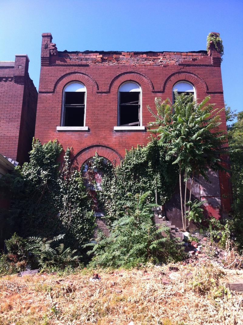 A vacant home in the 4th Ward neighborhood known as The Ville.