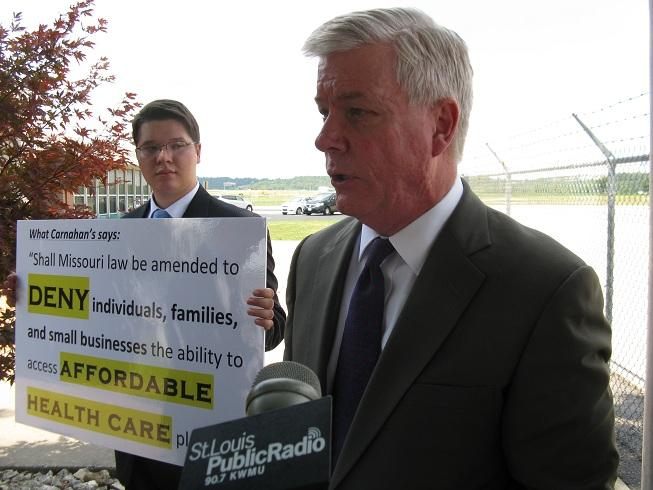 Mo. Lt. Gov. Peter Kinder (R) holds a press conference at Jefferson City Memorial Airport on his lawsuit against Sec. of State Robin Carnahan (D) regarding the language used for a ballot initiative on health care exchanges.