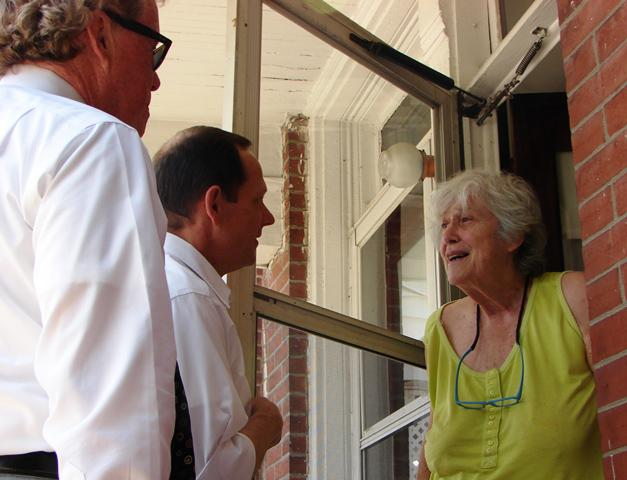 St. Louis mayor Francis Slay visits with a city resident on July 3, 2012. The mayor helped in going door-to-door to check on vulnerable residents who had not responded to calls from his office.