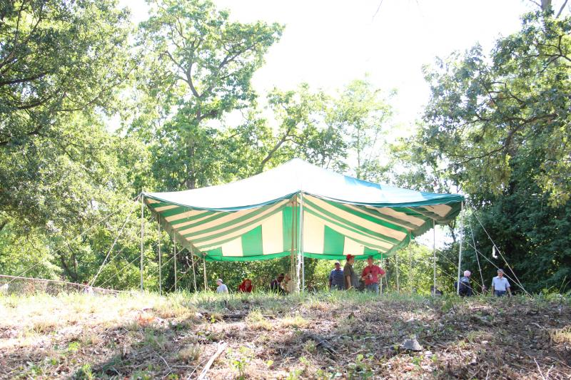 A big, green and white tent is erected where Rev. Larry Rice hopes to put new homeless camp in St. Louis County.