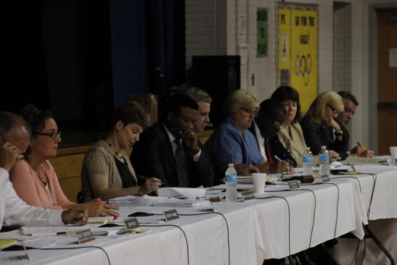 Members of the Edwardsville School Board listened to public comments during a school board meeting on Aug. 13, 2012.