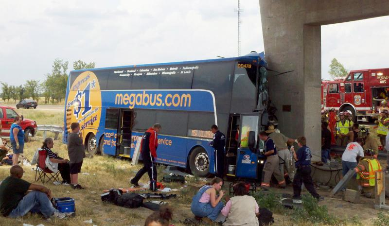 Rescue workers work to remove some of the riders of a Megabus headed to Kansas City from Chicago, after the bus hit a bridge support near Litchfield, Ill. on August 2, 2012.