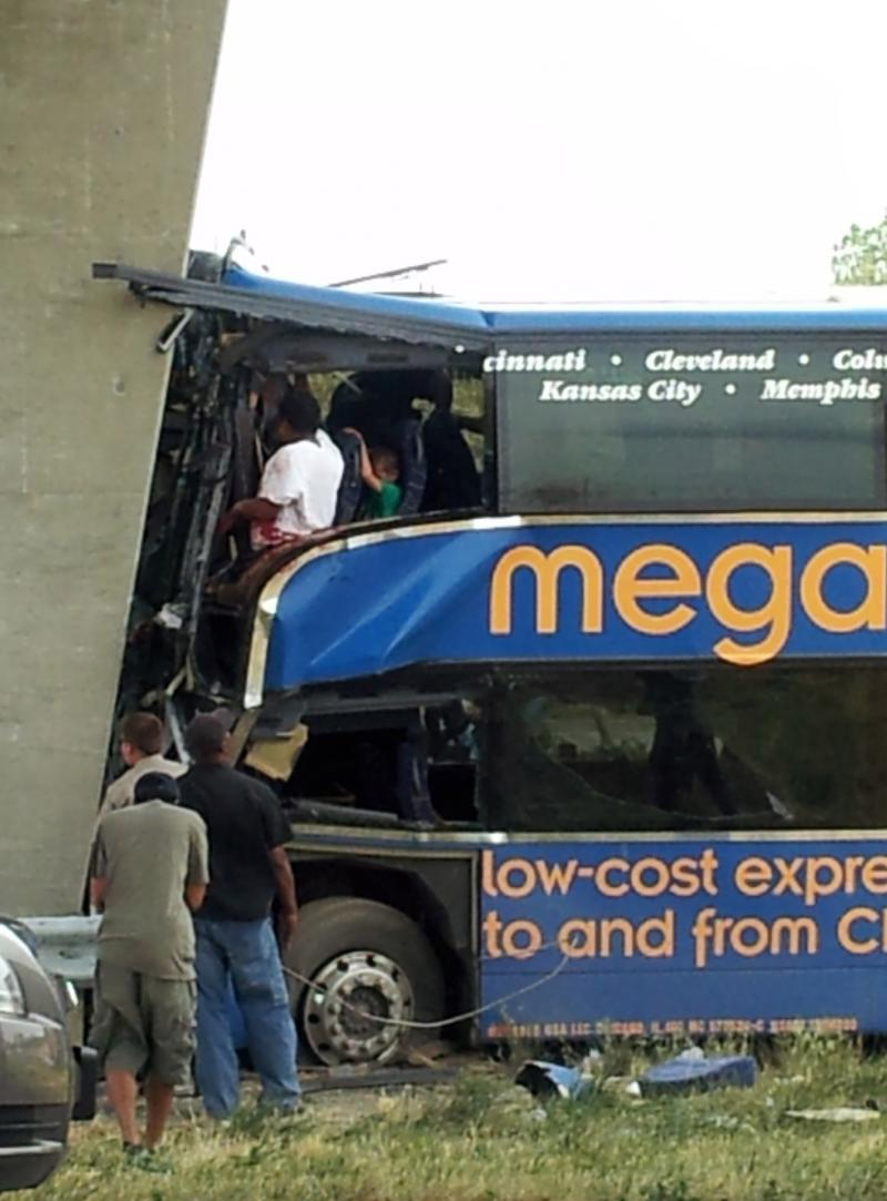 A view of the accident scene as workers try to remove some of the riders of the Megabus.