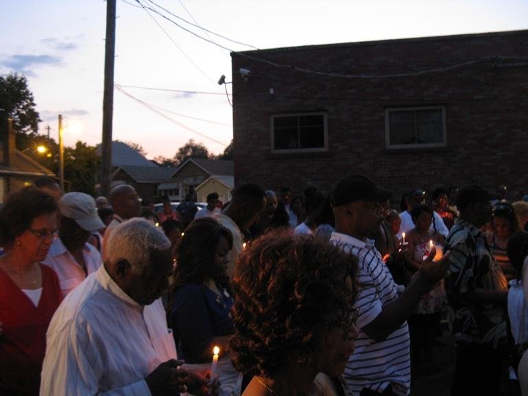 Ald. Freeman Bosley (foreground, white shirt) is among the mourners who lit candles Thursday night to honor Ald. Gregory Carter, who died Aug. 1 in a traffic accident.