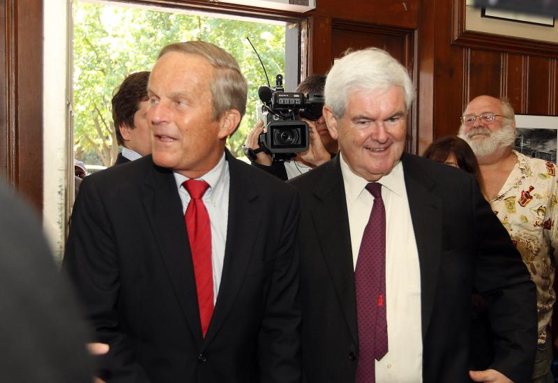 Todd Akin (left) and Newt Gingrich (right) speak to press on Monday. Akin addressed claims of changing his stance for campaign cash.