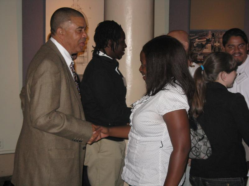 Congressman Lacy Clay (D-Mo) greets participants at a race and violence event in St. Louis on Saturday.