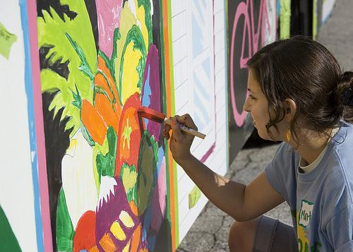 Painting a Metro bus at the Green Homes and Great Health Festival in 2009