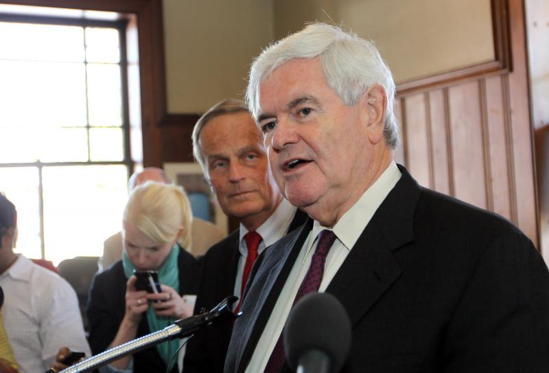 Former Speaker of the House Newt Gingrich speaks at a press conference as Rep. Todd Akin looks on. Gingrich is visiting the area to help Akin with his U.S. Senate campaign fundraising where he is opposing incumbent Claire McCaskill.