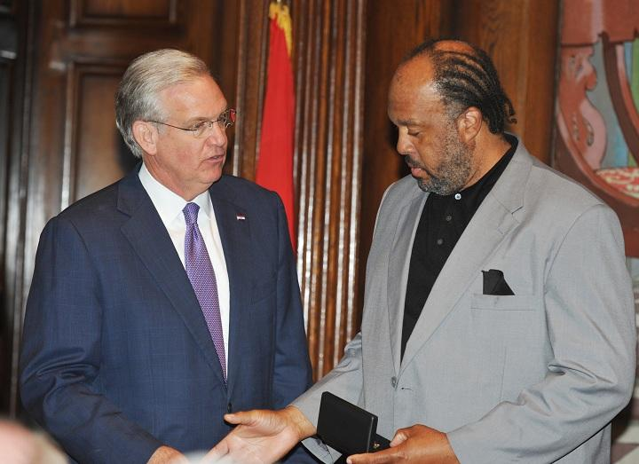 Joseph Love, Hall's uncle, accepts the Medal of Valor on Hall's behalf from Gov. Jay Nixon.