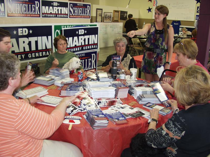 Before the rally, volunteers group pamphlets together to mail out to potential voters.