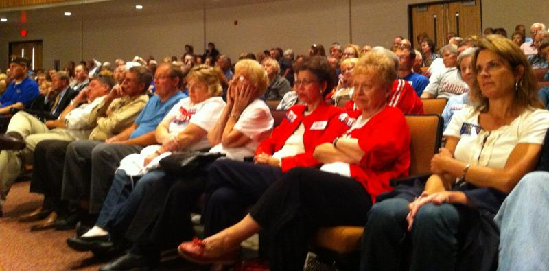 The Waterloo audience observes the candidates. In a twist, the Democrats wore red and the Republicans wore blue.
