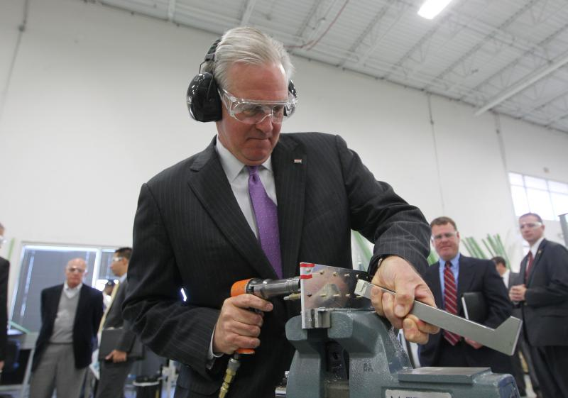MO Governor Jay Nixon operates a riveter at LMI Aerospace in St. Charles