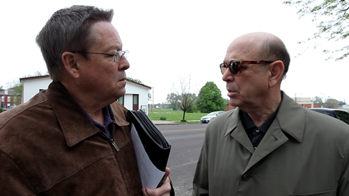Daniel Blake Smith and Richard Baron talk outside the former Pruitt-Igoe public housing project