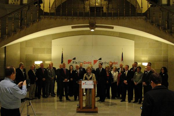 "Officials gather at the Missouri Capitol for an event announcing the formation of ""Fix the Debt Missouri."""