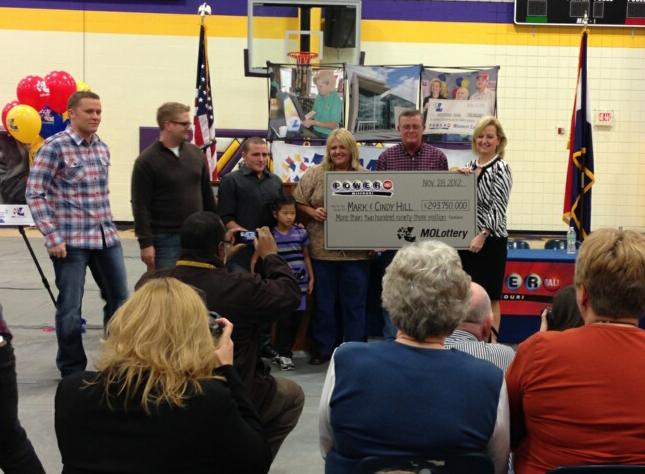 Mark and Cindy Hill, the Powerball winners from Dearborn, Mo. display their ceremonial winning check.