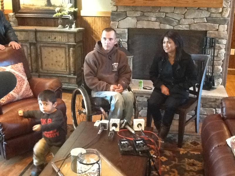Tyler Huffman, his wife Mauricia, and their son Matthew in the living room.