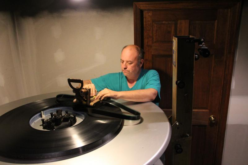 Bobby Sinnett readies hundreds of feet of film in the projection room of the Senate Theater in Elsberry, Mo.