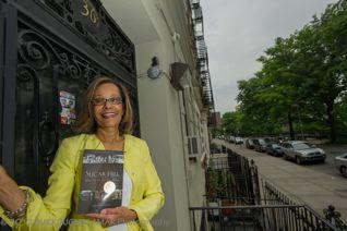Terry Baker Mulligan in front of 369 Edgecombe in Harlem, the building where she was born and lived until age 12
