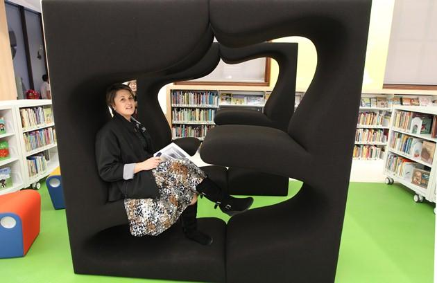 Visitors to the children's area of the main branch of the St. Louis Public Library try out a reading area