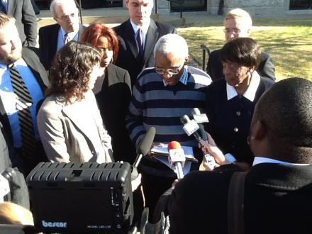 Lonzetta Taylor (R) watches as her son George Allen reads a statement on November 14 after being released from prison.