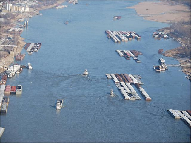 """As the river levels drop river depth decreases and the river banks recede. As a result the fleeting areas (areas where barges are picked up and dropped off) move closer to the channel. This makes for tight quarters while vessels navigate the river."""