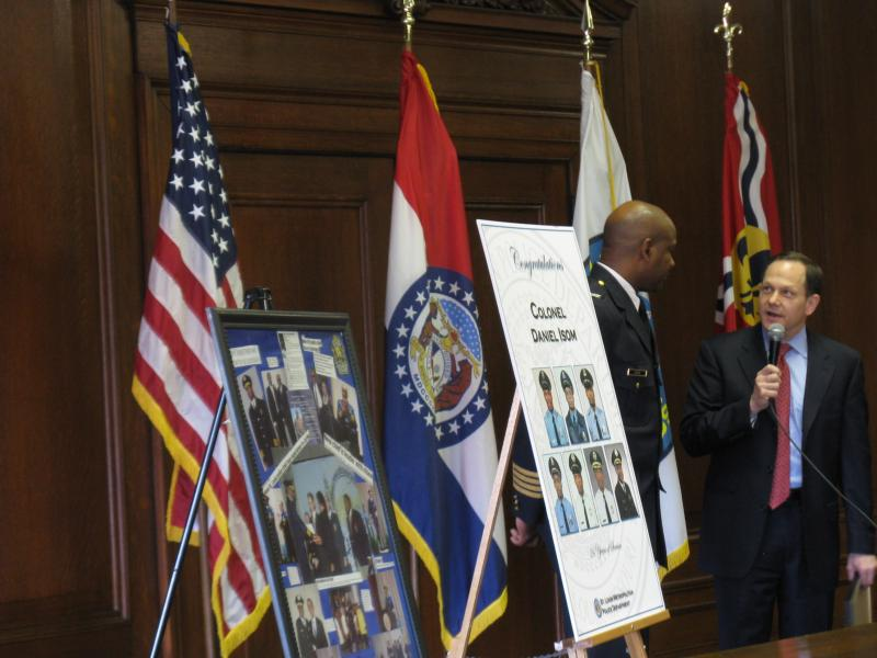 St. Louis Mayor Francis Slay (at right) speaking about St. Louis Police Chief Dan Isom (at left) on Dec. 4, 2012. Isom will be leaving the post to take a position at the University of Missouri - St. Louis.