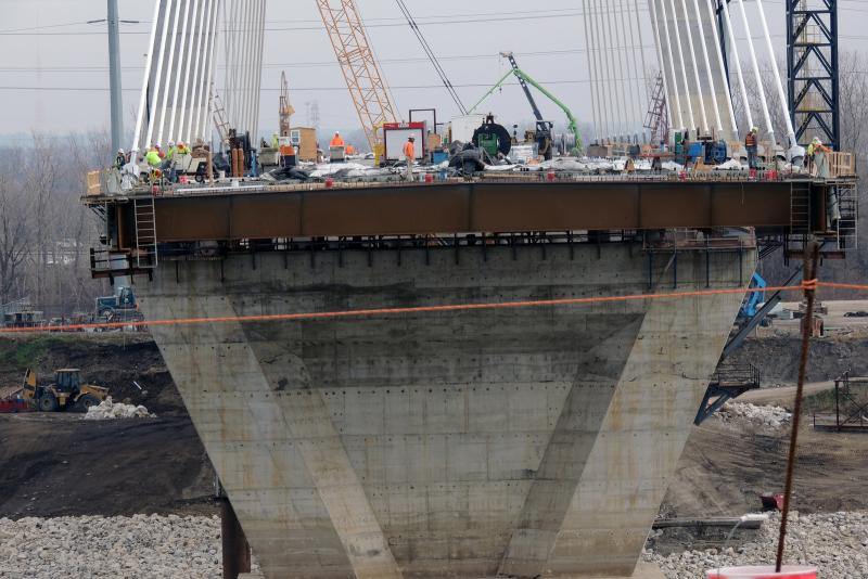 A wide shot of the work being done on the bridge.