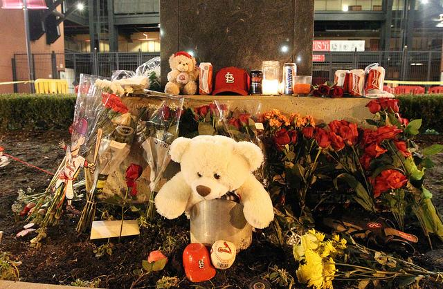 Some of the mementos left by fans at the base of the Stan Musial statue at Busch Stadium.