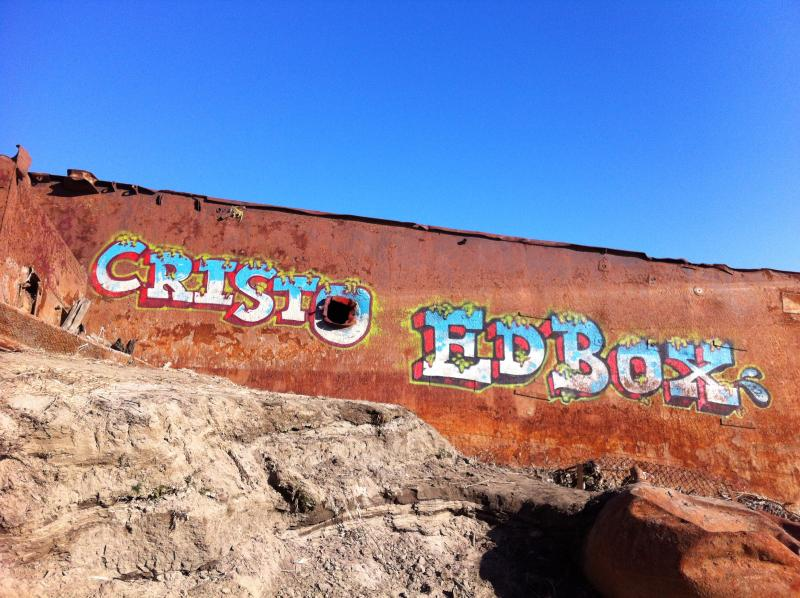 Low water has allowed artists to tag her rusted hull...including the work of STL's Ed Boxx, aka Redd Foxx