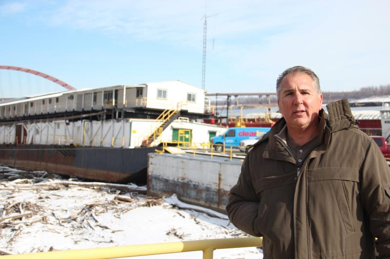 Dave Heyel, chief financial officer of JB Marine Service in south St. Louis County, stands in front of the company's floating office that now sits completely out of the water.