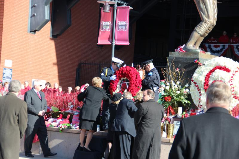 Family members lay a wreath at the foot of Stan Musial's statue in front of Busch Stadium on Saturday, Jan. 26, 2013.