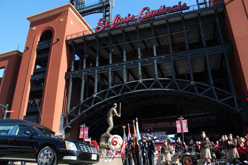 The hearse carrying Stan Musial passes in front of his statue in front of Busch Stadium on Saturday, Jan. 26, 2013.
