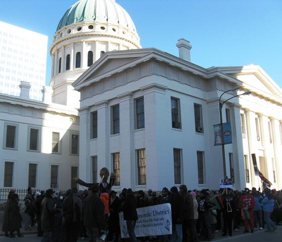 Marchers gather outside the Old Courthouse as part of the city's Martin Luther King Jr. Day celebration.