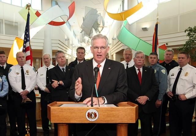 Gov. Jay Nixon, along with Missouri public safety director Jerry Lee and other law enforcement officials, pushes for the reinstatement of some exemptions to the state's Sunshine Law.