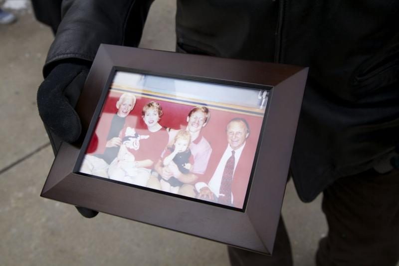 Phil Schroeder displays a cherished photo of his family with Musial in 1998
